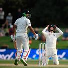 High hopes: England captain Joe Root reacts as batsman Ish Sodhi survives a delivery from Mark Wood yesterday