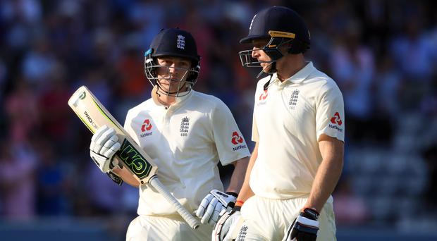Dom Bess, left, joined Jos Buttler in a fine rearguard action