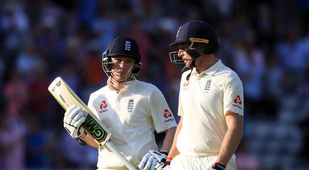 Dom Bess, left, fell one run short of another 50 for England (Adam Davy/PA)