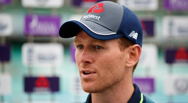 England's Eoin Morgan has agreed to a pre-series handshake (John Walton/PA)