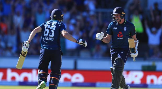England's Jos Buttler (left) and Jake Ball celebrate victory (Mike Egerton/PA)