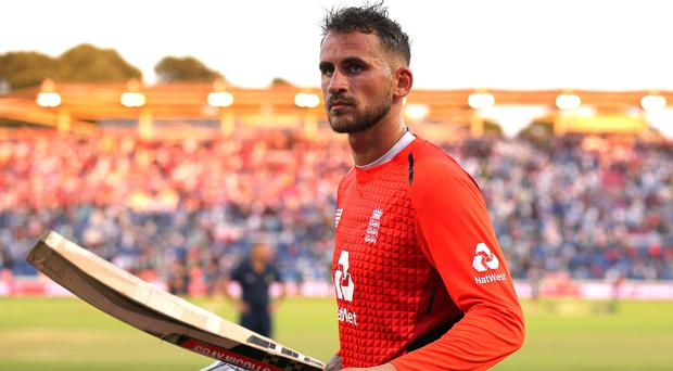 Alex Hales leaves the field after seeing England home in Cardiff (Mark Kerton/PA)
