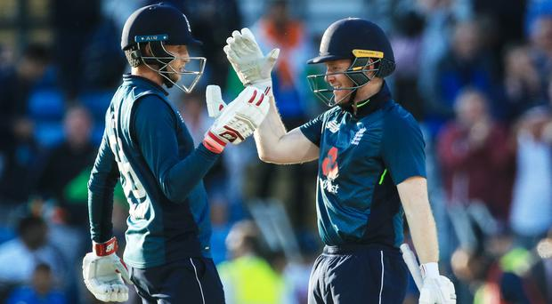 Joe Root, left, and Eoin Morgan guided England home (Danny Lawson/PA)