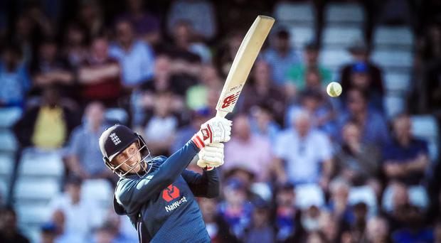 Joe Root hits the boundary that brought up his century (Danny Lawson/PA)