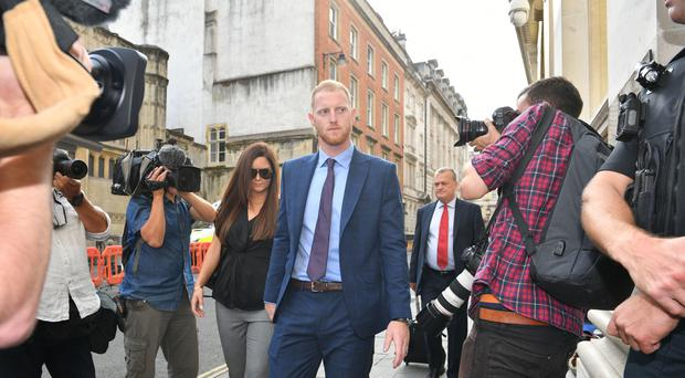 England cricketer Ben Stokes, with his wife Clare, arrives at Bristol Crown Court (Ben Birchall/PA)