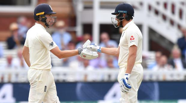 Chris Woakes and Jonny Bairstow combined to put England in control against India (Anthony Devlin/PA)