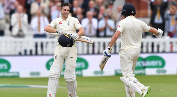 Chris Woakes, left, is all smiles after reaching his maiden Test hundred (Anthony Devlin/PA)