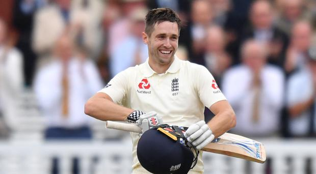England's Chris Woakes celebrates reaching his century (Anthony Devlin/PA)