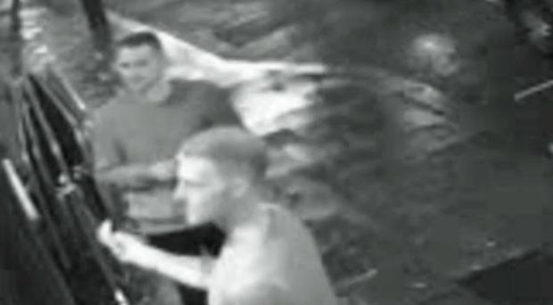 Still from handout CCTV issued by Avon and Somerset Police of England cricketers Ben Stokes (foreground) and Alex Hales outside the Mbargo nightclub in Bristol in the early hours of September 25, 2017. Stokes is seen offering cash to doorman Andrew Cunningham (who is out of frame).