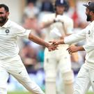 India's Mohammed Shami, left, celebrates taking the wicket of Ollie Pope (Mike Egerton/PA)