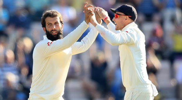 Moeen Ali, left, and Joe Root celebrate (Adam Davy/PA)