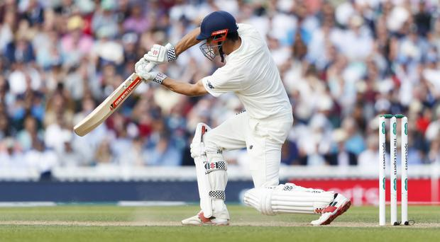 Alastair Cook was still battling away unbeaten on 46 on Sunday evening (John Walton/PA)