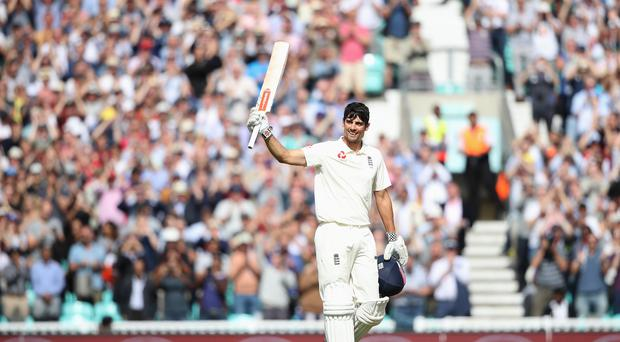 England's Alastair Cook celebrates reaching his century during his final Test match at The Kia Oval (Adam Davy/PA)