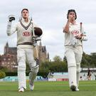 Surrey's Rikki Clarke and Morne Morkel (left) celebrate victory at Worcester. (David Davies/PA)