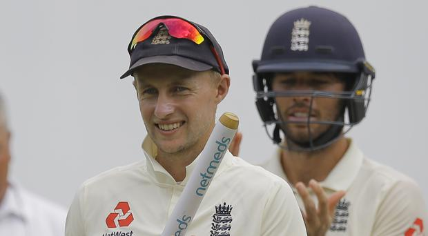 Joe Root, left, endured a sleepless night ahead of England's win over Sri Lanka (Eranga Jayawardena/AP)