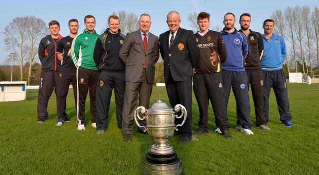 Raring to go: Players from NCU Premier League clubs with sponsor David Robinson of Robinson Services and NCU president Richard Johnson, (from left) Marcus McLean (Waringstown), Michael Gilmour (Carrick), Adam Berry (Lisburn), Alastair Shields (N Down), Ben Rose (Instonians), Neil Gill (Muckamore), Nigel Jones (CIYMS) and James Kennedy (CSN)