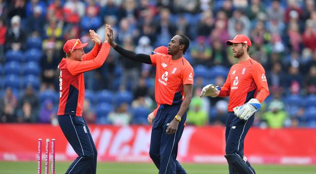 England's Jofra Archer and Eoin Morgan celebrate during the seven-wicket Twenty20 victory over Pakistan (Simon Galloway/PA)