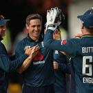 Chris Woakes, centre, celebrates his five-wicket haul (Nigel French/PA)