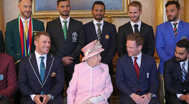 Morgan (bottom, second right) was pride of place at Buckingham Palace (Yui Mok/PA)