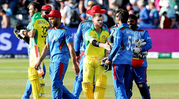 Australia's David Warner shakes hands with Afghanistan's Aftab Alam at the end of the match (Mark Kerton/PA)