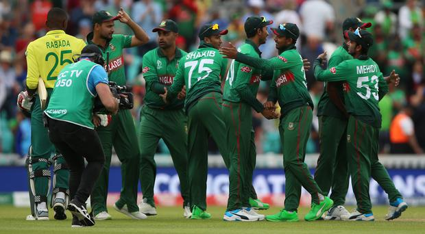 Bangladesh celebrate after their upset of South Africa (Nigel French/PA)
