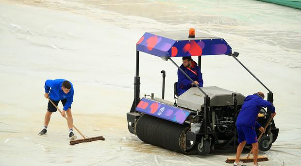 Grounds staff try and keep the rain off the pitch during the ICC Cricket World Cup group stage match at Hampshire Bowl, Southampton, on Monday (PA)