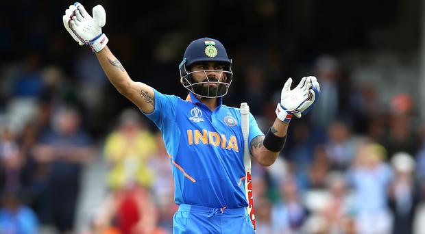 Virat Kohli will lead India into battle against New Zealand (Nigel French/PA)