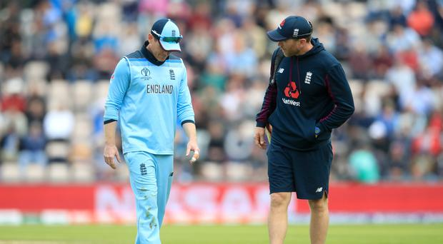 Eoin Morgan, left, walks off the pitch with an injury (Adam Davy/PA)