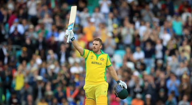 Aaron Finch celebrates reaching his century (Adam Davy/PA)