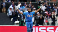 Rohit Sharma celebrates reaching his century (Martin Rickett/PA)