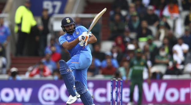India's Rohit Sharma plays a shot during the Cricket World Cup match between India and Pakistan at Old Trafford in Manchester, England, Sunday, June 16, 2019. (AP Photo/Dave Thompson)