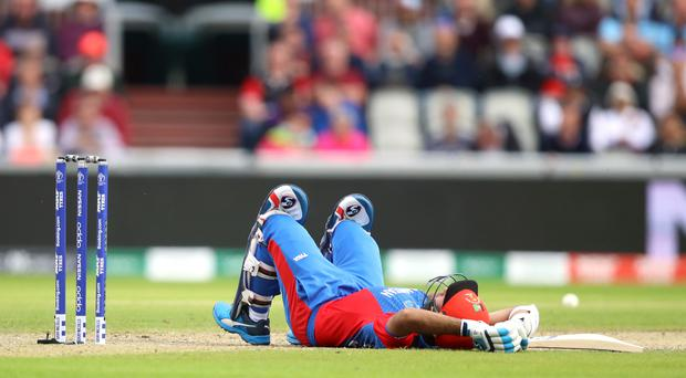 Hashmatullah was felled by a fast bouncer but batted on (Tim Goode/PA)