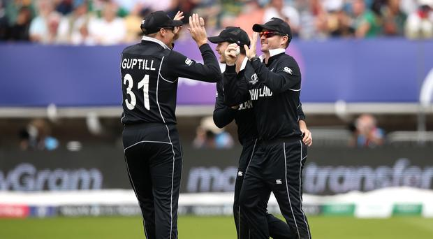 New Zealand's Colin Munro (right) celebrates the dismissal of South Africa's Aiden Markram with team-mates in their World Cup match at Edgbaston (Tim Goode/PA)