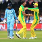 Australia's Mitchell Starc (centre) celebrates the dismissal of Joe Root (Adam Davy/PA).