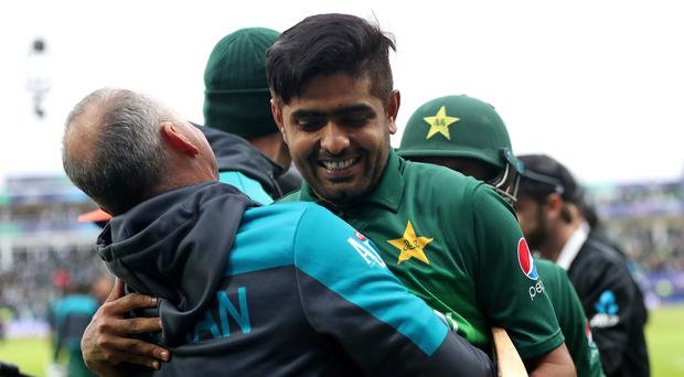 Babar Azam, right, celebrates Pakistan's World Cup victory over New Zealand (Simon Cooper/PA)