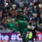 Pakistan's Babar Azam celebrates his century against New Zealand at Edgbaston (Simon Cooper/PA)