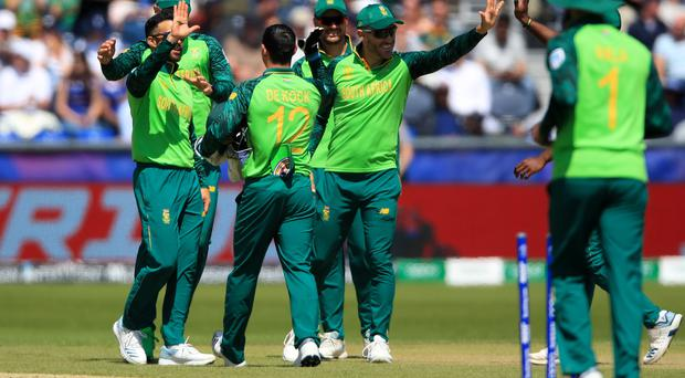 South Africa celebrate a Sri Lankan wicket on their way to a thumping win (Owen Humphreys/PA).