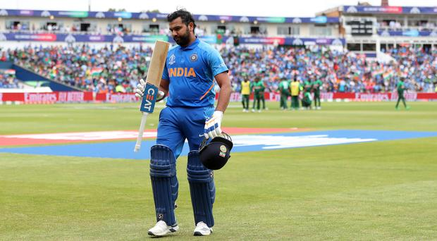Rohit Sharma acknowledges the applause after his century (David Davies/PA)