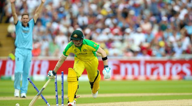 Australia's Steve Smith is run out by England's Jos Buttler during the ICC World Cup, Semi Final at Edgbaston, Birmingham.