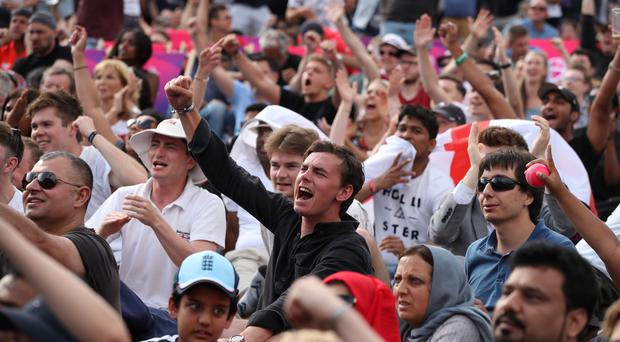 Cricket fans watching on a big screen (Chris Radburn/PA)