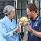 Prime Minister Theresa May with England cricket captain Eoin Morgan and the World Cup outside Downing Street (Yui Mok/PA)