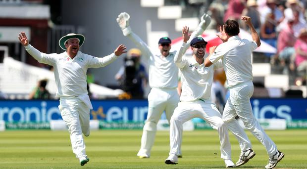 Tim Murtagh celebrates with his Ireland team-mates after bowling out Moeen Ali (Bradley Collyer/PA)