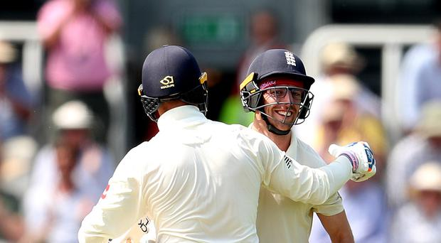England's Jack Leach (right) celebrates reaching 50 runs with team-mate Jason Roy (left) during day two of the Specsavers Test Series match at Lord's, London.
