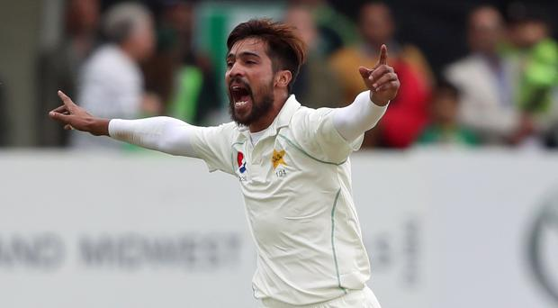 Mohammad Amir has announced his retirement from Test cricket (Niall Carson/PA)