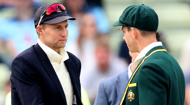 England's Joe Root (left) and Australia's Tim Paine (right) (Nick Potts/PA)