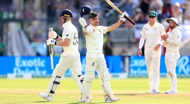 Rory Burns, centre, celebrates his century (Mike Egerton/PA)