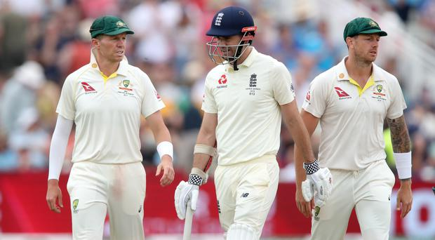 James Anderson, centre, batted in England's first innings but was not out in the field (Nick Potts/PA)