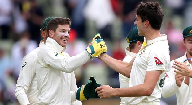 Australia's Tim Paine and Pat Cummins celebrate defeating England by 251 runs during day five of the Ashes Test match at Edgbaston, Birmingham.