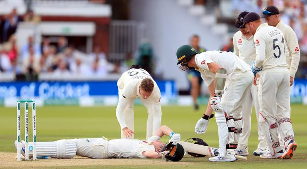 Steve Smith was floored by a vicious bouncer from Jofra Archer (Mike Egerton/PA).