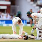 Australia's Steve Smith lies on the ground after being floored by a fierce delivery from Jofra Archer (Mike Egerton/PA).